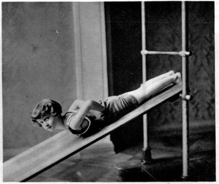 Dviganje gornjega telesa na poševni deski